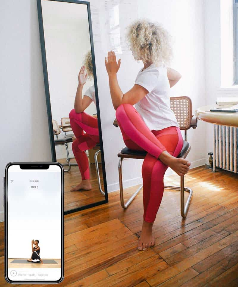 NADI X wearable smart clothese with biometrics product young woman in front of mirror